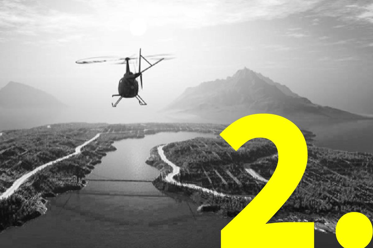 Helikopter die over rivier en bergen vliegt ter illustratie van helikopterview bij het ontwikkelen van presentaties.