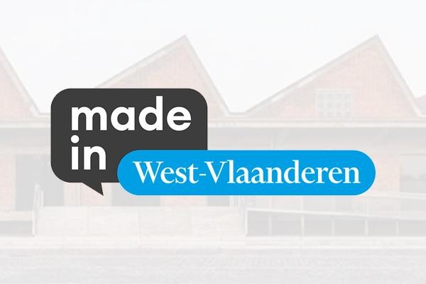 Logo Made in West-Vlaanderen met gebouw Hangar K op de achtergrond.